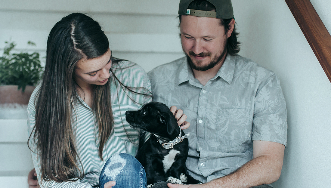 couple at home with dog