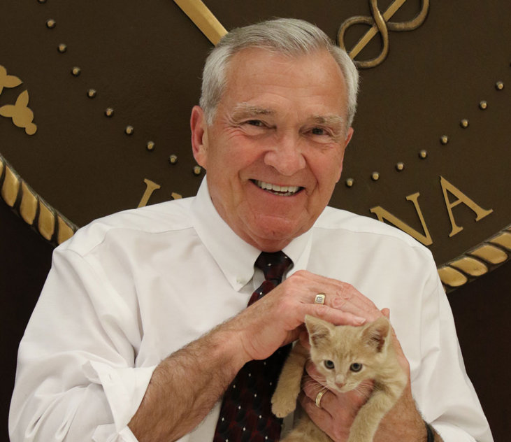Mayor Tom Henry holding a cat