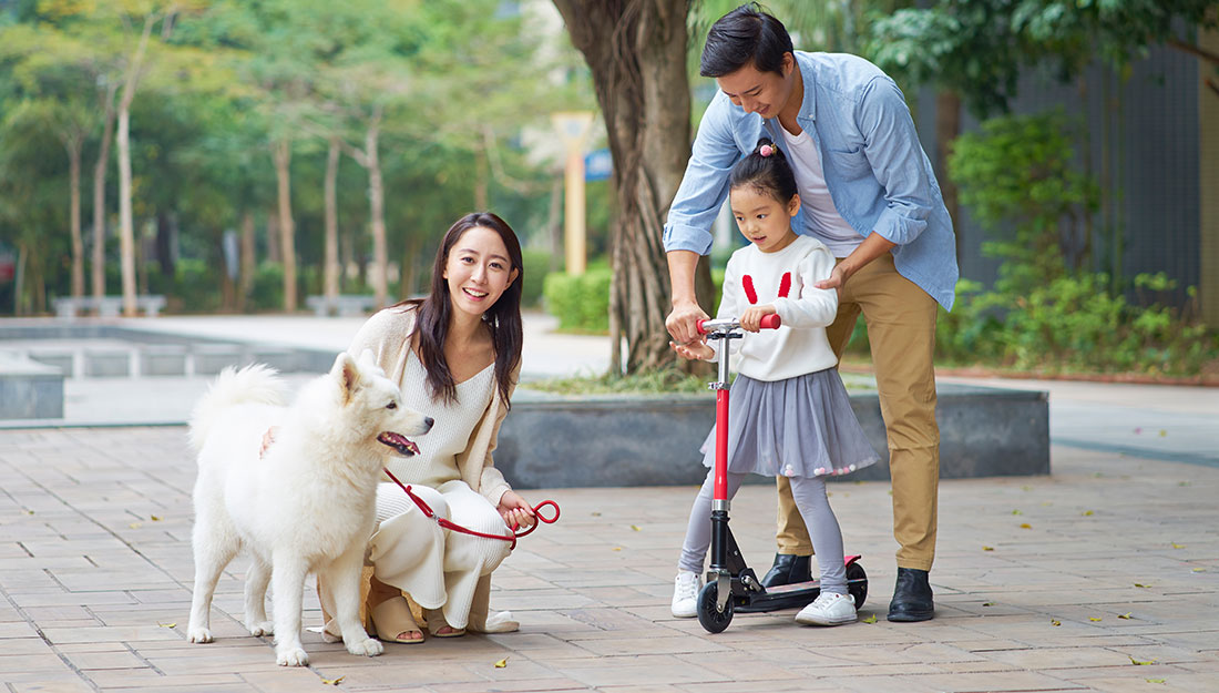 family out walking with dog