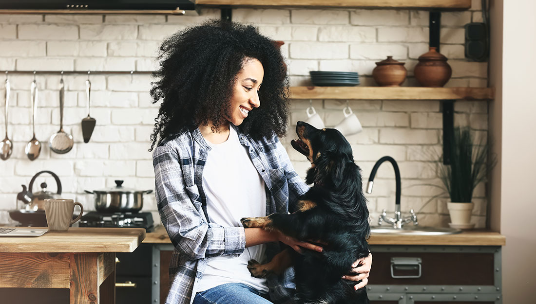 woman in kitchen with her dog