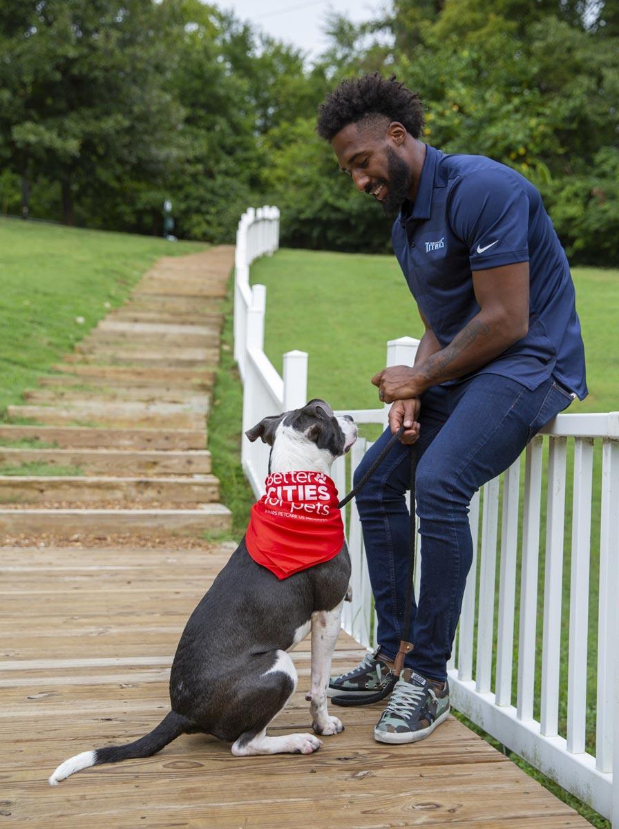 Logan Ryan with an adoptable shelter dog.