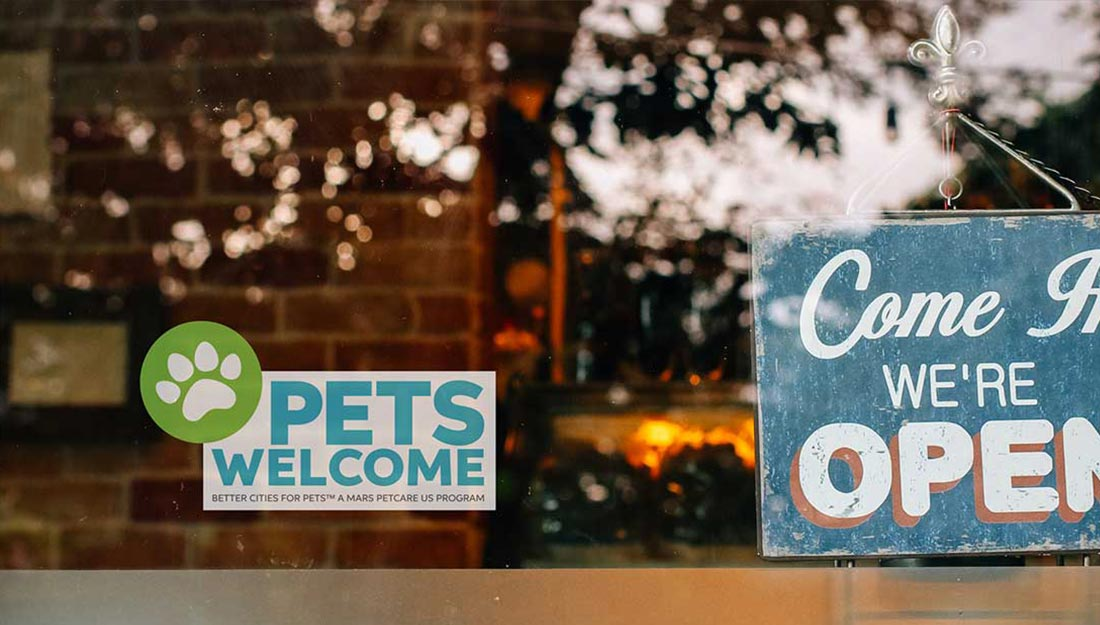 store sign with pet-friendy sticker